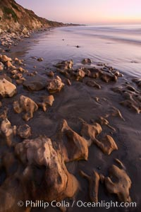 Rocks, sand, ocean and sea cliffs, sunset, Carlsbad, California