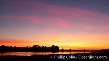 Sunset reflected in the still waters of Batiquitos Lagoon. Batiquitos Lagoon, Carlsbad, California, USA, natural history stock photograph, photo id 22284