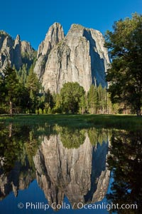 Cathedral Rocks at sunrise, reflected in a spring meadow flooded by the Merced River, Yosemite National Park, California