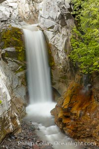 Christine Falls is a 69 foot (21m) waterfall in Mount Rainier.  The lower section of Christine Falls is  known for the bridge that spans across it, Mount Rainier National Park, Washington
