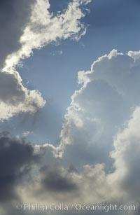 Clouds form in a blue sky
