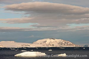Clouds and rugged Antarctic coastline, Devil Island
