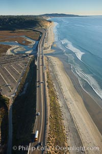 Coast Highway 101, looking south from Del Mar, with Los Penasquitos Marsh on the left and the cliffs of Torrey Pines State Reserve and La Jolla in the distance, San Diego, California