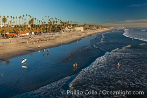 The coast of Oceanside California, waves and surfers, beach houses, just before sunset, winter, looking south. Oceanside Pier, Oceanside, California, USA, natural history stock photograph, photo id 27598