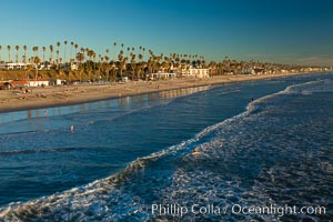 The coast of Oceanside California, waves and surfers, beach houses, just before sunset, winter, looking south. Oceanside Pier, Oceanside, California, USA, natural history stock photograph, photo id 27599