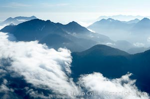 Coastal mountains and clouds, rising above Bedwell Sound (hidden by clouds) and Clayoquot Sound, near Tofino on the west coast of Vancouver Island