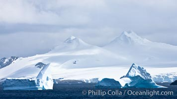 Coronation Island, is the largest of the South Orkney Islands, reaching 4,153' (1,266m) above sea level.  While it is largely covered by ice, Coronation Island also is home to some tundra habitat, and is inhabited by many seals, penguins and seabirds
