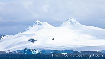 Coronation Island, is the largest of the South Orkney Islands, reaching 4,153&#39; (1,266m) above sea level.  While it is largely covered by ice, Coronation Island also is home to some tundra habitat, and is inhabited by many seals, penguins and seabirds