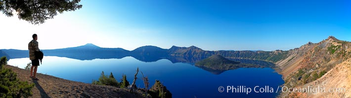 Self portrait at sunrise, panorama of Crater Lake.  Crater Lake is the six-mile wide lake inside the collapsed caldera of volcanic Mount Mazama. Crater Lake is the deepest lake in the United States and the seventh-deepest in the world. Its maximum recorded depth is 1996 feet (608m). It lies at an altitude of 6178 feet (1880m), Crater Lake National Park