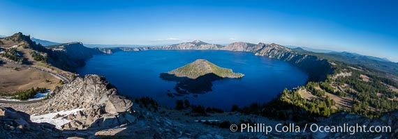 Panorama of Crater Lake from Watchman Lookout Station, panoramic picture. The Watchman Lookout Station No. 168 is one of two fire lookout towers in Crater Lake National Park in southern Oregon. For many years, National Park Service personnel used the lookout to watch for wildfires during the summer months. It is also a popular hiking destination because it offers an excellent view of Crater Lake and the surrounding area