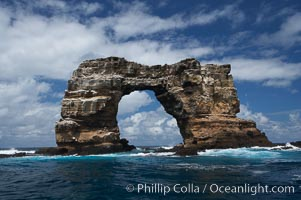 Darwins Arch, a dramatic 50-foot tall natural lava arch, rises above the ocean a short distance offshore of Darwin Island. Darwin Island, Galapagos Islands, Ecuador