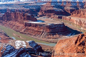 Dead Horse Point Overlook, with the Colorado River flowing 2,000 feet below.  300 million years of erosion has carved the expansive canyons, cliffs and walls below and surrounding Deadhorse Point, Deadhorse Point State Park, Utah