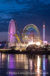Del Mar Fair and San Dieguito Lagoon at Night.  Lights from the San Diego Fair reflect in San Dieguito Lagooon, with the train track trestles to the left