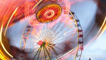 Ferris wheel and fair rides at sunset, blurring due to long exposure, Del Mar Fair