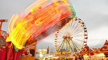Ferris wheel and fair rides at sunset, blurring due to long exposure. Del Mar Fair, Del Mar, California, USA, natural history stock photograph, photo id 20873