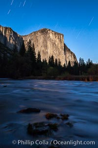 El Capitan and star trails, at night, illuminated by the light of the full moon, Yosemite National Park, California