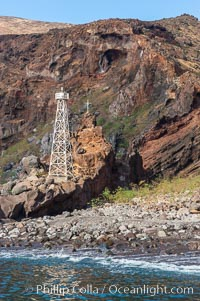 Lighthouse and cross mark the site of a small fishing shack and old chapel and prison near the north end of Guadalupe Island (Isla Guadalupe)