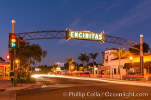 Image 28841, Encinitas city sign lit at night over Highway 101. Encinitas, California, USA, Phillip Colla, all rights reserved worldwide. Keywords: beach, california, coast, coast highway, dusk, encinitas, evening, highway 101, neon, night, san diego, sign, sunset.