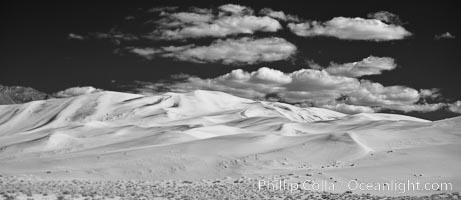 """Eureka Dunes.  The Eureka Dunes are California's tallest sand dunes, and one of the tallest in the United States.  Rising 680' above the floor of the Eureka Valley, the Eureka sand dunes are home to several endangered species, as well as """"singing sand"""" that makes strange sounds when it shifts, Death Valley National Park"""