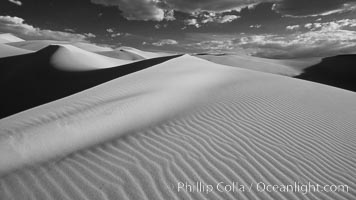 Eureka Sand Dunes, infrared black and white.  The Eureka Dunes are California&#39;s tallest sand dunes, and one of the tallest in the United States.  Rising 680&#39; above the floor of the Eureka Valley, the Eureka sand dunes are home to several endangered species, as well as &#34;singing sand&#34; that makes strange sounds when it shifts, Death Valley National Park
