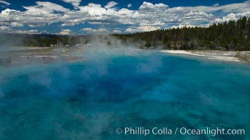 Excelsior Geyser, now dormant, was formerly the worlds largest geyser. It still produces immense runoff into the Firehole River: 4,500 gallons per minute, or 6 million gallons per day. It is located in Midway Geyser Basin, Yellowstone National Park, Wyoming
