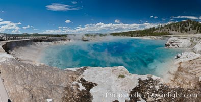 Panorama of Excelsior Geyser, now dormant, was formerly the worlds largest geyser. It still produces immense runoff into the Firehole River: 4,500 gallons per minute, or 6 million gallons per day. It is located in Midway Geyser Basin, Yellowstone National Park, Wyoming