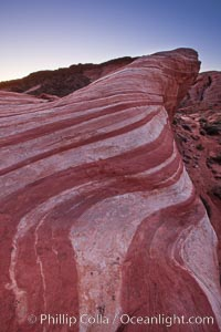 The Fire Wave, a beautiful sandstone formation exhibiting dramatic striations, striped layers in the geologic historical record. Valley of Fire State Park, Nevada, USA