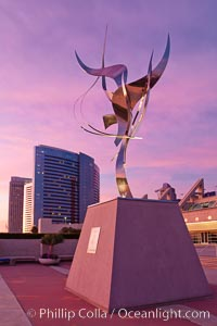 Flama de la Amistad, a statue by Leonardo Nierman.  Installed in the San Diego Convention Center�s outdoor amphitheater, Flame of Friendship is a polished, stainless-steel statue set against San Diego Bay weighing 3,700 pounds and standing 20 feet tall and eight feet wide