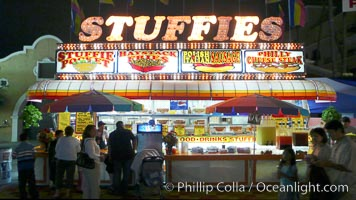 Food vendors at the Del Mar Fair, famous for their tasty, greasy, salty, fattening and generally unwholesome food, which visitors eat by the ton.  Bright lights at night