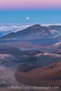 Full Moon and Earth Shadow over Haleakala crater, Maui, Hawaii.  The dark band on the horizon is the shadow of the earth, while the lighter pink band is atmosphere that is still lit by the setting sun