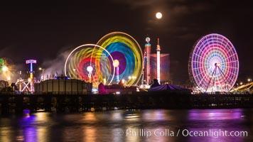 Full moon rising at night over the San Diego County Fair.  Del Mar Fair at night