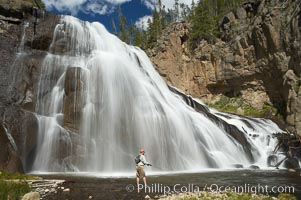 Fly fishing below Gibbon Falls. This flyfisherman hiked up the Gibbon River to reach the foot of Gibbon Falls, Yellowstone National Park, Wyoming