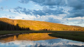 Sunrise and clouds above the Gibbon River, Gibbon Meadows, Yellowstone National Park, Wyoming
