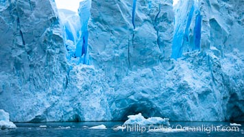 A glacier fractures and cracks, as the leading edge reaches the ocean.  The pieces will float away to become icebergs. Neko Harbor, Antarctic Peninsula, Antarctica, natural history stock photograph, photo id 25739