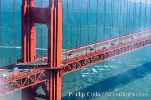 Commuter traffic crosses the Golden Gate Bridge, viewed from the Marin Headlands. San Francisco