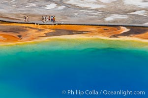 Grand Prismatic Spring displays a stunning rainbow of colors created by species of thermophilac (heat-loving) bacteria that thrive in narrow temperature ranges.  The blue water in the center is too hot to support any bacterial life, while the outer orange rings are the coolest water.  Grand Prismatic Spring is the largest spring in the United States and the third-largest in the world.  Midway Geyser Basin, Yellowstone National Park, Wyoming