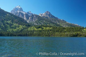 The Teton Range rises above Taggart Lake, Grand Teton National Park, Wyoming
