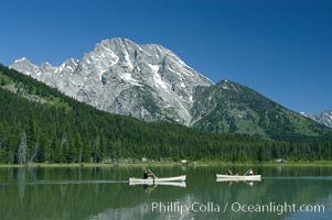Canoers paddle across String Lake below Mount Moran, Grand Teton National Park, Wyoming
