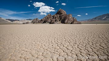 The Grandstand, standing above dried mud flats, on the Racetrack Playa in Death Valley, Death Valley National Park, California