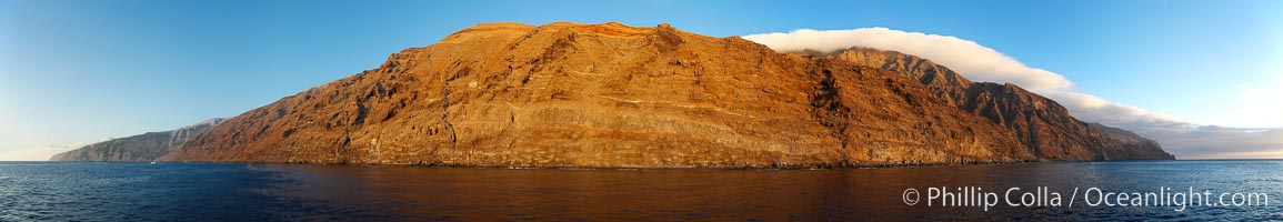 Guadalupe Island at sunrise, panorama.  Volcanic coastline south of Pilot Rock and Spanish Cove, near El Faro lighthouse.,  Copyright Phillip Colla, image #19497, all rights reserved worldwide.
