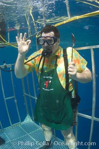 A Canadian television chef waves to the camera from a shark cage at Guadalupe Island.  Huh?, Guadalupe Island (Isla Guadalupe)