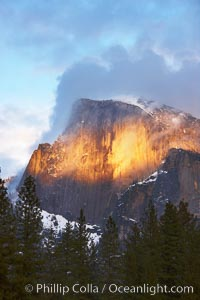 Half Dome and storm clouds at sunset, viewed from Sentinel Bridge, Yosemite National Park, California