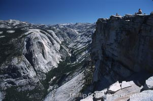 Hikers atop Summit of Half Dome, view of Tenaya Canyon, Yosemite National Park, California