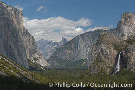 Gates of Yosemite Valley, viewed from Wawona Tunnel.  El Capitan (left), Bridalveil Falls and Cathedral Rocks (right), Half Dome (center) in the distance.  Yosemite National Park, Spring, Tunnel View