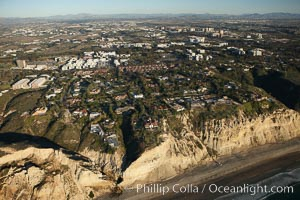 Homes in La Jolla, atop the cliffs above famous Black&#39;s Beach, with University of California San Diego in the background
