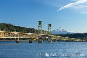 The Hood River Bridge is a truss bridge with a vertical lift that spans the Columbia River between Hood River, Oregon and White Salmon, Washington.  The bridge is currently the second oldest road bridge across the Columbia between Washington and Oregon. It was built by the Oregon-Washington Bridge Company and opened on December 9, 1924. The original name was the Waucoma Interstate Bridge