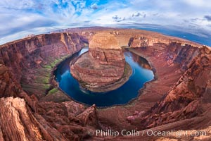 Horseshoe Bend. The Colorado River makes a 180-degree turn at Horseshoe Bend. Here the river has eroded the Navajo sandstone for eons, digging a canyon 1100-feet deep. Horseshoe Bend, Page, Arizona, USA