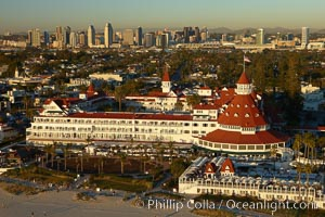 Hotel del Coronado, known affectionately as the Hotel Del.  It was once the largest hotel in the world, and is one of the few remaining wooden Victorian beach resorts.  It sits on the beach on Coronado Island, seen here with downtown San Diego in the distance.  It is widely considered to be one of Americas most beautiful and classic hotels. Built in 1888, it was designated a National Historic Landmark in 1977. San Diego, California, USA, natural history stock photograph, photo id 22287