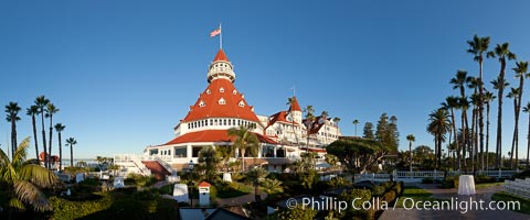 Hotel del Coronado, known affectionately as the Hotel Del. It was once the largest hotel in the world, and is one of the few remaining wooden Victorian beach resorts. It sits on the beach on Coronado Island, seen here with downtown San Diego in the distance. It is widely considered to be one of Americas most beautiful and classic hotels. Built in 1888, it was designated a National Historic Landmark in 1977. San Diego, California, USA, natural history stock photograph, photo id 27104