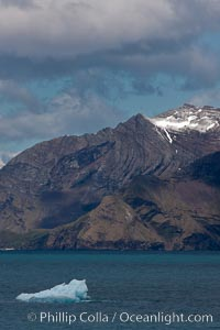 Iceberg and mountains, Cumberland Bay, near Grytviken. Grytviken, South Georgia Island, natural history stock photograph, photo id 24552